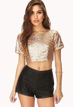 Short rose gold t-shirt with black mini shorts
