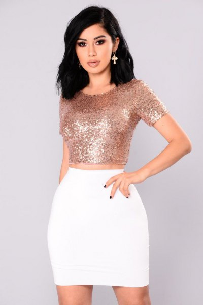 Rose gold figure-hugging crop top with white mini skirt