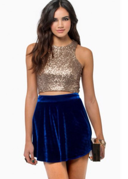 sparkling rose gold crop top with blue velvet mini skirt