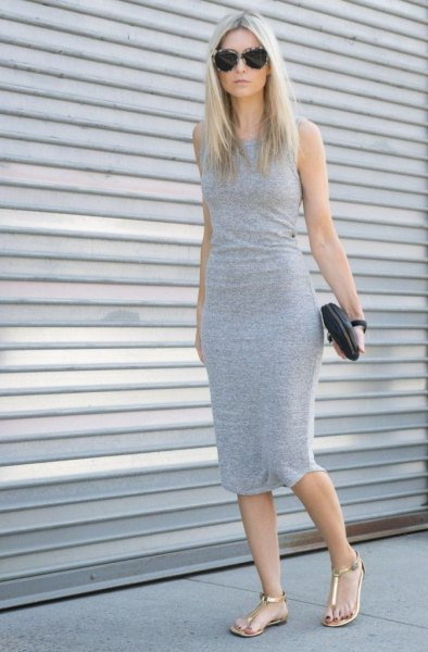 gray, form-fitting midi dress with golden thong sandals