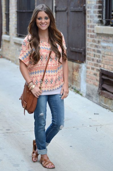 pale yellow top with tribal print and jeans with blue cuffs