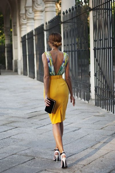 white backless top with floral pattern and mustard-colored high-rise pencil skirt