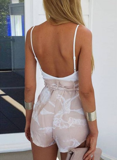 white tank top with a low back and blushing pink mini shorts