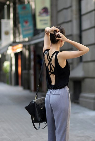 black tank top with gray cotton trousers with a relaxed fit