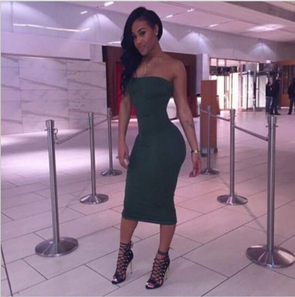 green form-fitting midi dress with strappy heels