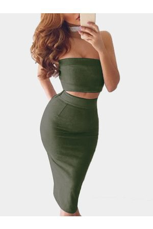 Short tube top with a figure-hugging midi skirt