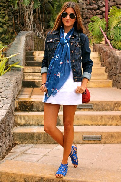 dark denim jacket with white mini dress with royal blue sandals