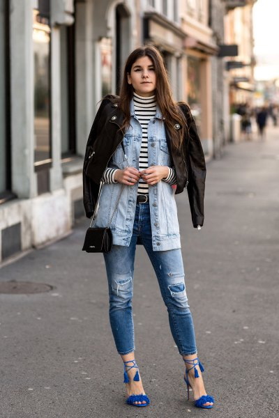 Denim jacket with torn jeans and royal blue strappy sandals