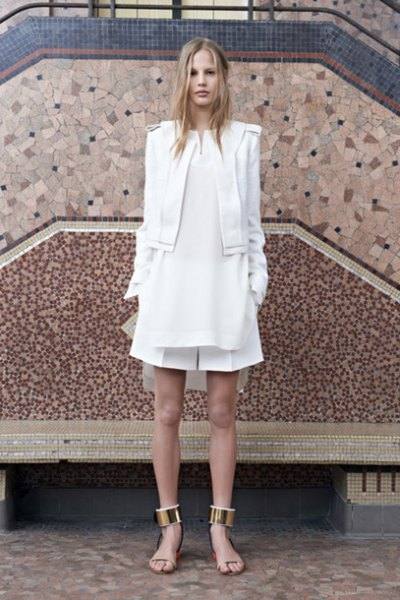 white blazer with flared mini dress with collar and flat sandals with gold ankle strap