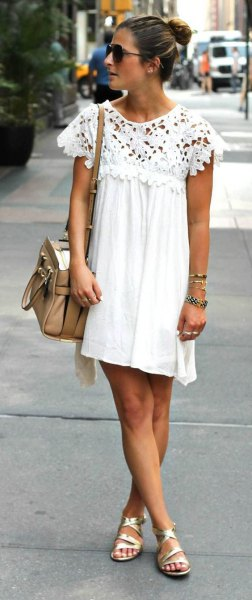 Pleated swing mini dress with white lace sleeves and gold strappy sandals