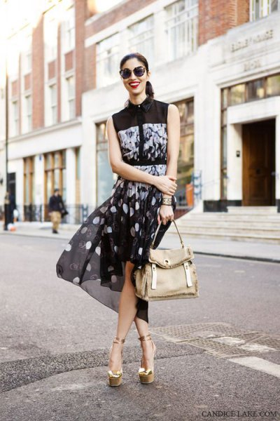 black sleeveless blouse with dotted chiffon mini skirt and gold sandals
