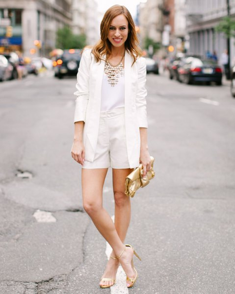 white blazer with matching flowing shorts and blouse