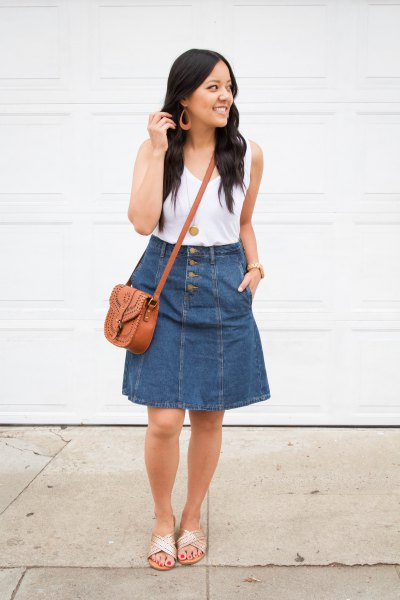 white tank top with a scoop neck and knee-length skirt in blue denim