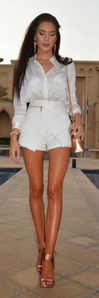 white silk shirt with buttons, matching mini-skort and golden sandals