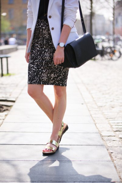 white blazer with black blouse and printed pencil skirt