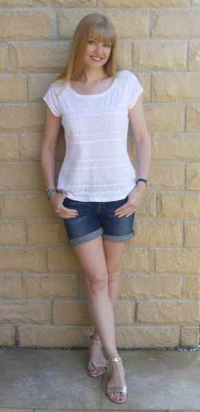 white t-shirt with blue denim shorts with cuffs and silver sandals