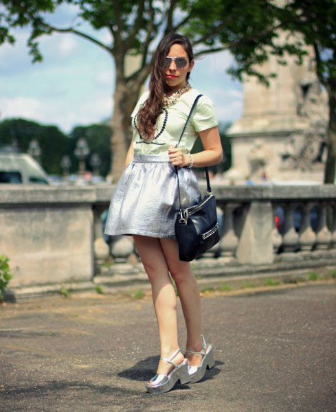Light pink top with silver skater skirt and platform sandals