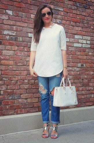 white tunic blouse with blue torn jeans with cuffs and silver sandals