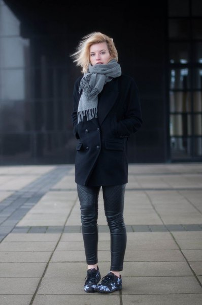 black wool coat with gray fringed scarf and leather pants