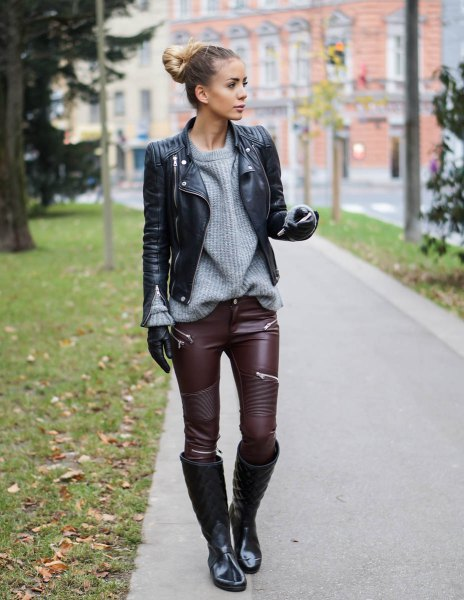 black biker jacket with gray crew-neck sweater