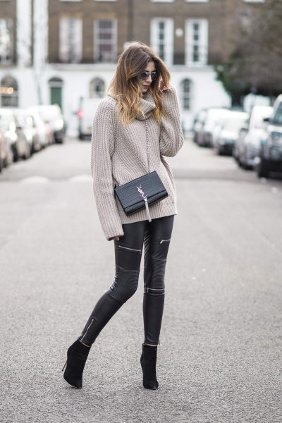 gray, ribbed sweater with a waterfall neckline and black leather pants