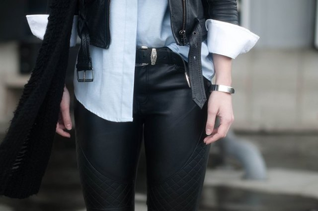 black leather jacket with white shirt and biker pants with belt