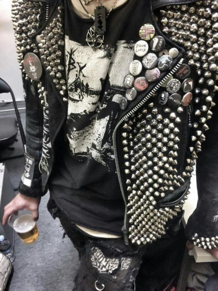 Leather jacket with rivets and graphic t-shirt