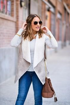 gray and white Sherpa vest with a striped long-sleeved T-shirt