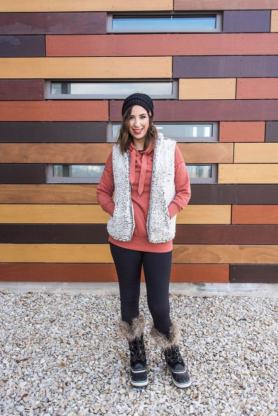 gray sherpa vest with red hoodie and leggings