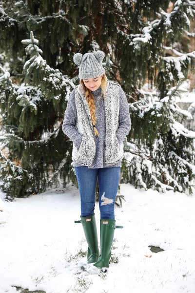 gray sherpa vest with sweater and blue jeans