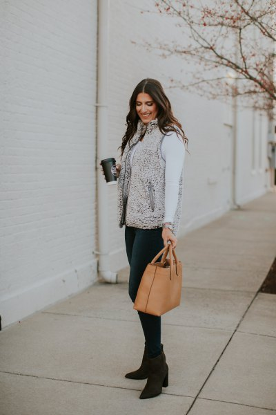 gray sherpa vest with white mock-neck long-sleeved t-shirt