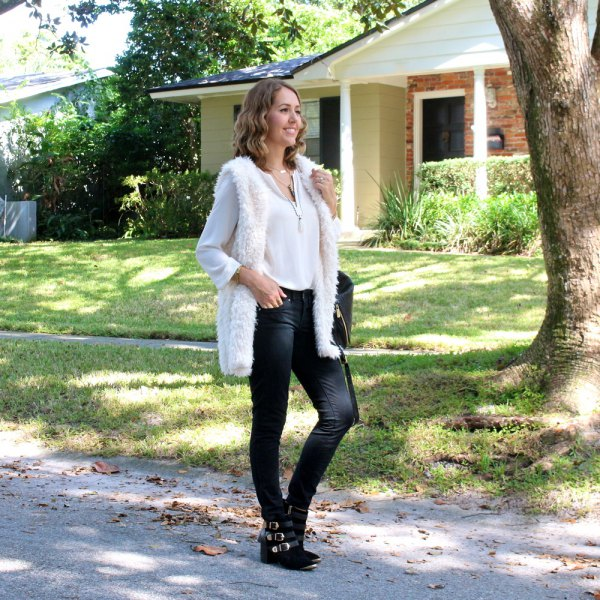 white fuzzy longline vest with chiffon blouse and skinny jeans