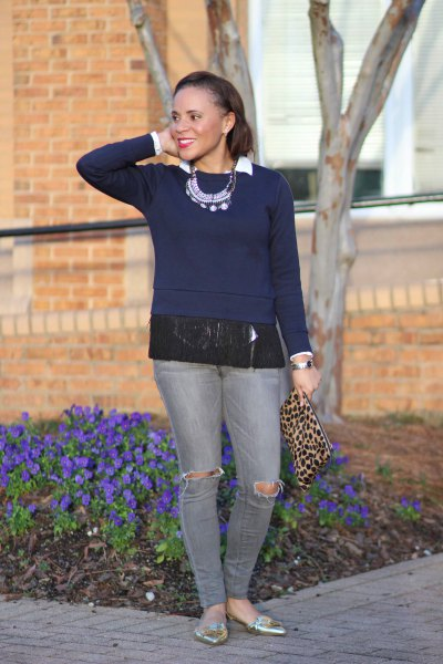 Dark blue fringe sweater with gray jeans