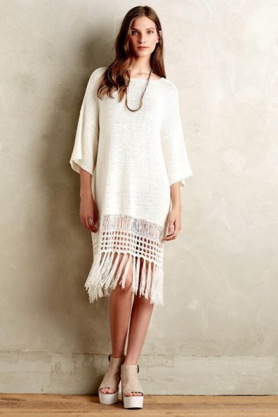 white tunic-sweater fringe dress with open toe shoes