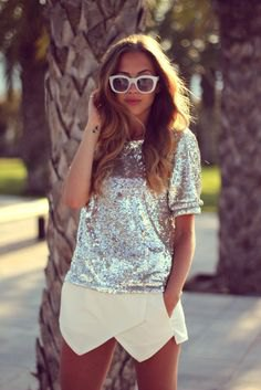 silver sequin top with short sleeves and light yellow mini skort