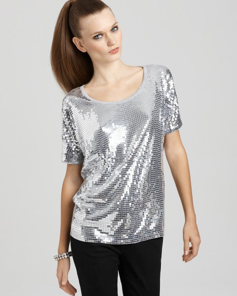 silver top with scoop neck and black slim fit trousers