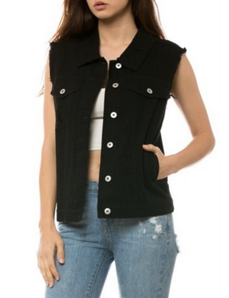 unwashed black denim vest with white crop top and blue torn jeans