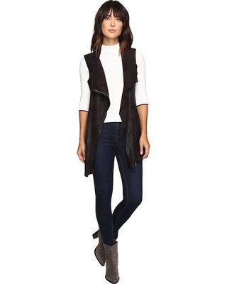 black longline denim vest with mock-neck sweater
