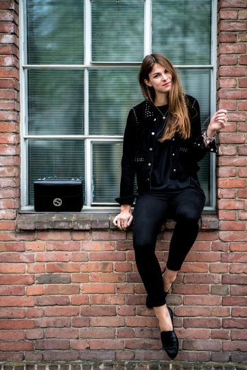 black biker jacket with rivets, skinny jeans and leather low shoes