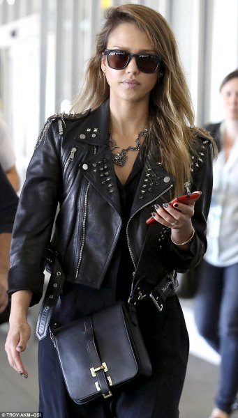 waisted and short leather jacket with black knee-length shirt dress