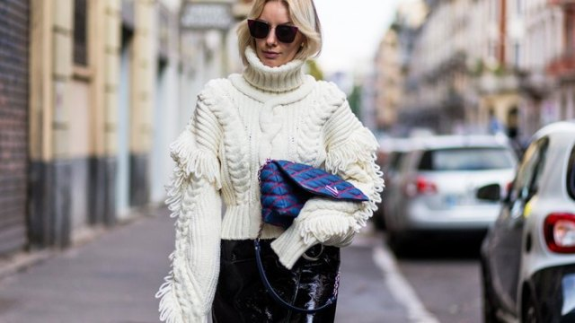 white turtleneck with cable pattern and black leather pants