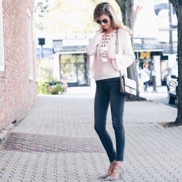 white, short-cut sweater with neckline and gray skinny jeans