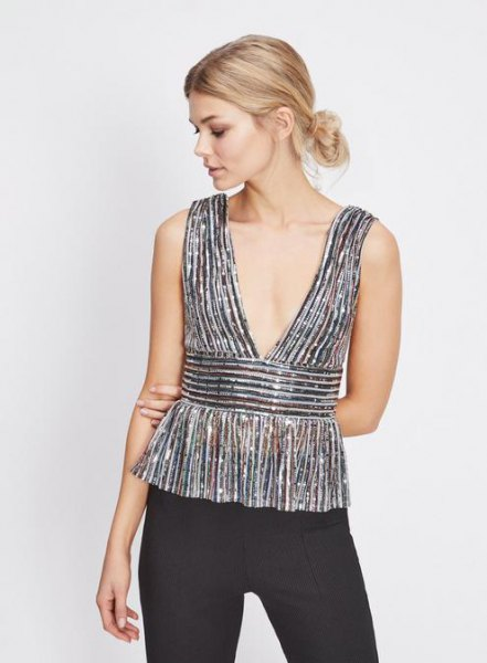 silver peplum top with deep v-neck and black skinny jeans