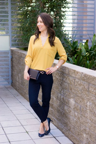 lighter mustard-colored blouse with V-neck and chinos
