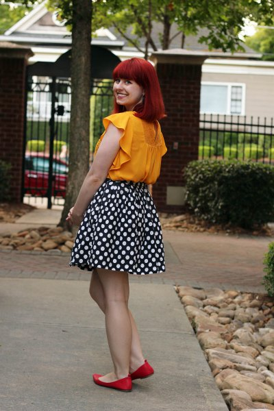 sleeveless blouse in mustard color with black and white dotted skater skirt