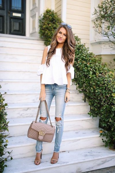 white chiffon blouse with cold shoulder and torn slim fit jeans