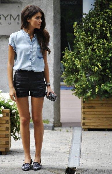 Light blue chambray short-sleeved shirt with black, mini-coated denim shorts