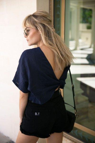 Navy blue v-neck t-shirt with black denim shorts