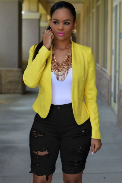 yellow blazer with long, high-waisted shorts made of black denim