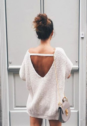 white, chunky, oversized sweater with open back and mini shorts